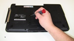 On the bottom of the laptop, unscrew the single 2.5mm x 5mm retaining screw and use a screw driver to slide the optical drive out of the bay by pushing on the metal bracket where the screw was.