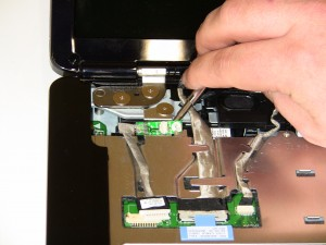 Remove the Bluetooth card by unscrewing the retaining screw and lifting the card up off of the laptop.