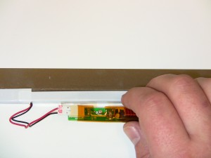 Remove the LCD inverter by disconnecting the cable from the right side.