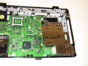 Lift the Express Card Slot up to remove it off of the motherboard.
