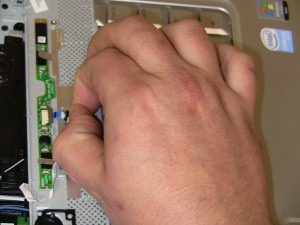 Disconnect the media control cable under the power button cover and lift off the power button cover.