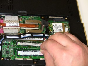 Gently pull the 1525/1526 memory stick out of the memory slot.