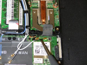 Loosen the antenna cables from the base assembly antenna routing channel.