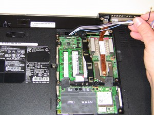 Remove the antenna wires from the mini wireless cards.