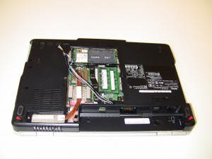 Remove the (2) 2.5mm x 5mm hinge screws holding the LCD display assembly to the base of the laptop.