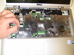 Unplug the display cable from the motherboard.