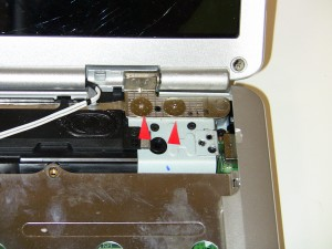 Unscrew the (2) 2.5mm x 3mm – 10 mm wafer hinge screws from the right display hinge.