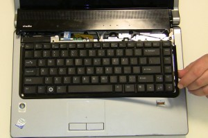Remove the Keyboard Trim Plastic. Start by lifting the plastic at the top corner and working your way around the keyboard.