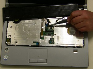 Carefully lift the Center Control Media Buttons Cover cable latch and remove the Center Control Media Buttons Cover.
