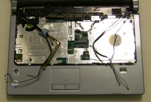 Disconnect the LCD Cable, the Camera Cable, and the Power Button Cable.
