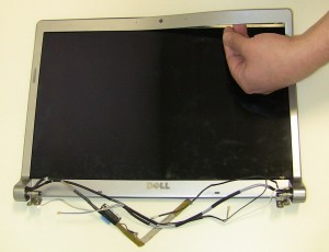 Unsnap the bezel from the back assembly starting on the camera side and working your way around the edges. The Bezel may be glued down to the screen so it may be difficult to remove.
