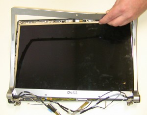 Lift the bezel away from the display assembly.