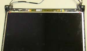 Remove the (2) 2.5mm x 5mm screws on the top left and right of the screen.