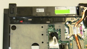 Turn the base assembly over and remove the optical drive screw.