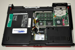 On the bottom of the laptop, loosen the wireless antenna cables and unscrew the 2.5mm x 5mm left and right hinge screws.
