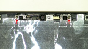 Remove the web camera from the LCD back cover assembly.