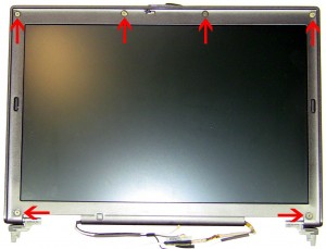 Remove the (6) 2.5mm x 5mm x 1.5mm bezel screws.