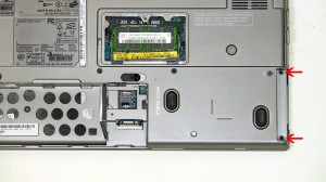 Loosen the 2 non-removable PCI slot screws.