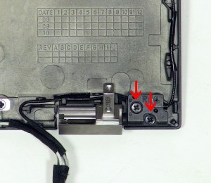 Remove the (2) 2.5mm x 5mm left hinge screws.