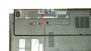 Slide the latch to the left and slide the battery out of the laptop.