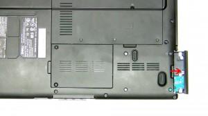Unscrew the (4) 3mm x 3mm hard drive screws.