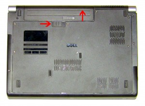 Slide the battery up and lift it away from the laptop.