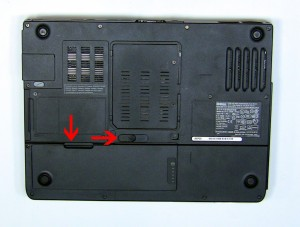 On the bottom of the laptop, slide the battery latch to the right and lift the battery out.
