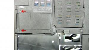 Remove the (2) 3mm x 3mm hard drive screws.