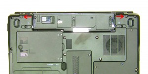 Remove the (2) 2.5mm x 8mm hinge screws on the back of the laptop.