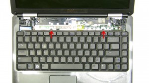 Carefully lift the keyboard up and position it above the power button.