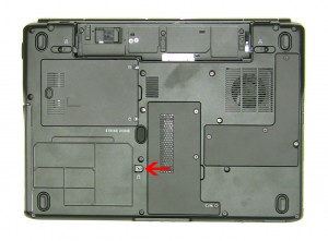 Remove the 2.5mm x 5mm optical drive retaining screw.