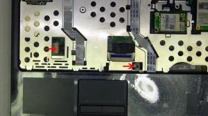 Remove the (3) 2.5mm x 5mm top palmrest screws.
