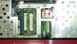 Remove the retaining screw and lift the wireless card out of the slot.