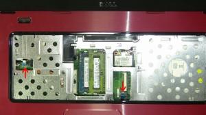 Unplug the 2 palmrest cables.