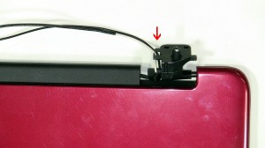 Loosen the LCD Cable from the routing channels on the left hinge.