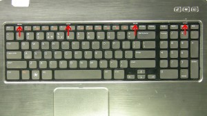 Using a flathead screwdriver or plastic scribe, press in the 4 latches to release the keyboard.
