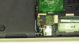Remove the screw and remove the mSATA SSD hard drive.