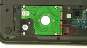 Lift and slide the hard drive out of the laptop using the tab.