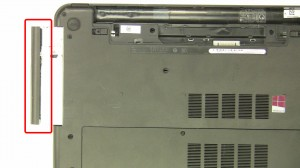 Slide the optical drive out of the laptop.