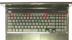Press in the 4 keyboard clips to loosen the keyboard.