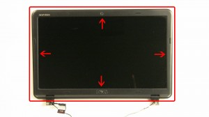 Unsnap the edge of the LCD bezel and remove it from the LCD assembly.