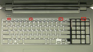 Using a small flat heat screwdriver or a plastic scribe, pry the keyboard from the tabs on the palmrest.