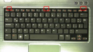 Press the keyboard latches in and turn the keyboard over.