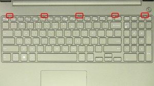 Using a small flat head screwdriver, press in the keyboard latches and carefully remove and turn over the keyboard.
