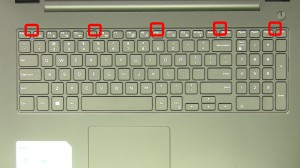 Press in the keyboard latches and loosen the keyboard.