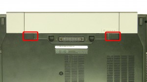 Slide the latches over and slide the battery out of the laptop.