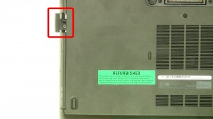 Press the optical drive latch in to eject it.