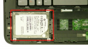 Slide the hard drive over & remove the Hard Drive.