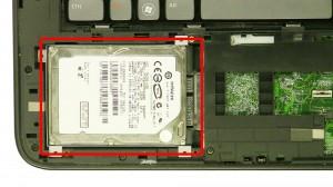 Slide the hard drive over & remove the Hard Drive.