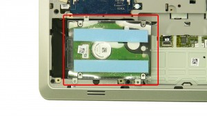 Lift the Hard Drive out and move it to the right.